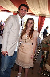 HRH PRINCESS BEATRICE OF YORK and singer DARIUS DANESH at the Veuve Clicquot sponsored Gold Cup Final or the British Open Polo Championship held at Cowdray Park, West Sussex on 17th July 2005.<br />