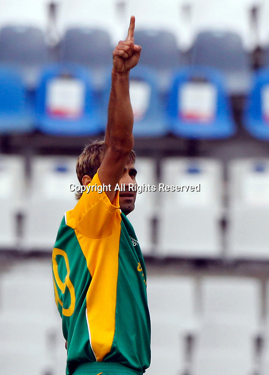 03.03.2011 Cricket World Cup from the Punjab Cricket Association Stadium, Mohali in Chandigarh. West indies v Netherlands. Imran Tahir of South Africa celebrates the wicket of Mudassar Bukhari during the match of the ICC Cricket World Cup between Netherlands and West Indies.