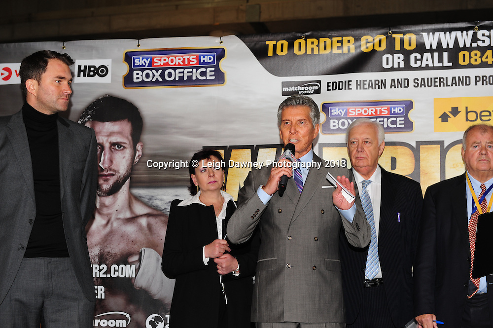 MC Michael Buffer, Eddie Hearn (left) and BBBC officials at the Public Weigh In for Carl Froch v Mikkel Kessler fight at London Piazza, 02 Arena, London, United Kingdom. 24.05.13. Credit © Leigh Dawney Photography 2013.