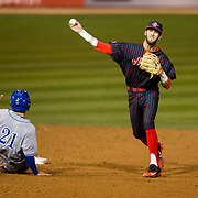 16 February 2018: San Diego State baseball opened up the season against UCSB at Tony Gwynn Stadium. San Diego State infielder David Hensley (22) turns a double play in the top of the eighth inning. The Aztecs beat the Gauchos 9-1. <br /> More game action at sdsuaztecphotos.com
