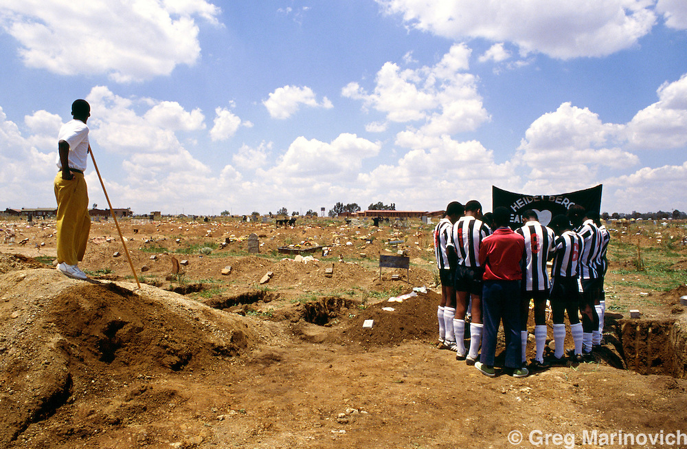 Ratanda Township, Heidelberg, Transvaal, South Africa 1993. A football teams buries their teammate who was killed while playing soccer by crossfire between ANC and IFP fighters.