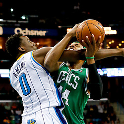 Mar 20, 2013; New Orleans, LA, USA; New Orleans Hornets small forward Al-Farouq Aminu (0) fouls Boston Celtics power forward Chris Wilcox (44) during the second half of a game at the New Orleans Arena. The Hornets defeated the Celtics 87-86. Mandatory Credit: Derick E. Hingle-USA TODAY Sports