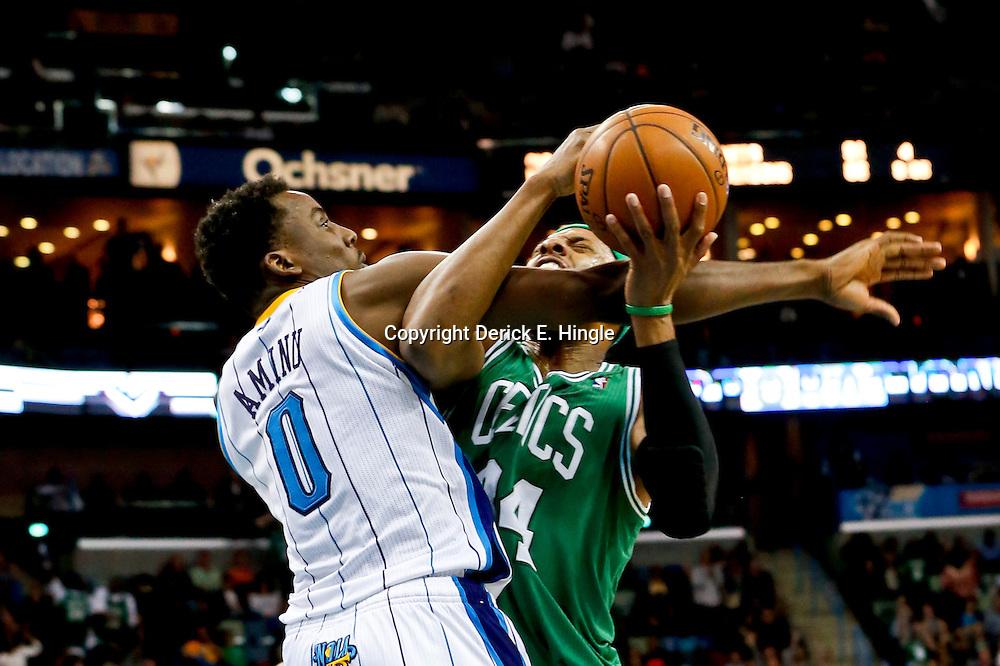 Mar 20, 2013; New Orleans, LA, USA; New Orleans Hornets small forward Al-Farouq Aminu (0) fouls Boston Celtics power forward Chris Wilcox (44) during the second half of a game at the New Orleans Arena. The Hornets defeated the Celtics 87-86. Mandatory Credit: Derick E. Hingle-USA TODAY Sports