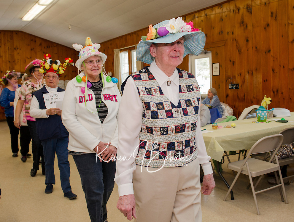 Eleanor Leclerc peaks out from under her Blue Bonnet during the Laconia Elders Friendship Club annual Easter bonnet parade Wednesday afternoon at the Leavitt Park Clubhouse.  (Karen Bobotas/for the Laconia Daily Sun)