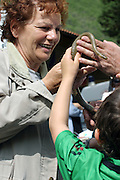 A woman and a child holding a snake during the snake Procession of Cocullo, one of the oldest pagan Christian celebrations still held today in Italy, on Thursday, May 5, 2005. Saint Domenico, the peculiar Saint of the event, was thought to protect from and heal snake bites. **ITALY OUT**