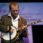 BREVARD, NC - SEPTEMBER 12 :  Graham Sharp on stage as the Steep Canyon Rangers perform in the Mountain Song Festival at The Brevard Music Center on September 12, 2009, in Brevard, North Carolina, USA. (Photo by Logan Mock-Bunting/Getty Images)