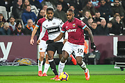 West Ham United Midfielder Michail Antonio (30) and Fulham Defender Ryan Sessegnon (3) in action during the Premier League match between West Ham United and Fulham at the London Stadium, London, England on 22 February 2019.