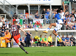 Ellis Harrison of Bristol Rovers tries to block a clearance from Paul Downing of Blackburn Rovers - Mandatory by-line: Neil Brookman/JMP - 14/04/2018 - FOOTBALL - Memorial Stadium - Bristol, England - Bristol Rovers v Blackburn Rovers - Sky Bet League One