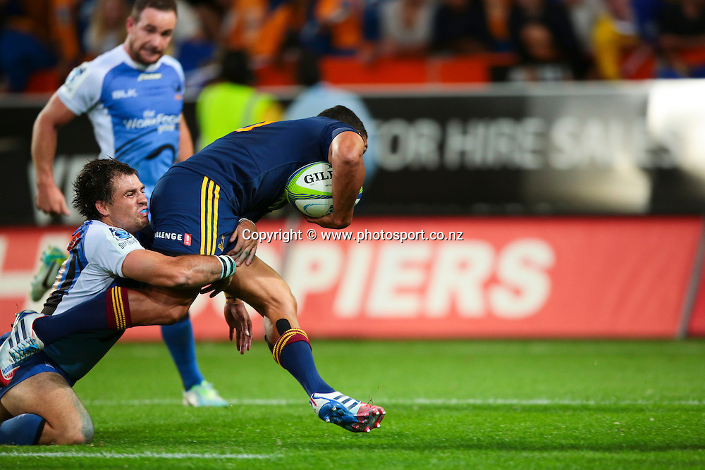 Force flyhalf Sias Ebersohn prevents Highlanders' Lima Sopoaga from scoring a try during the Round 5 Super Rugby match between Otago Highlanders and Western Force at Forsyth Barr Stadium, Dunedin. 15 March 2014. Photo: Derek Morrison/www.photosport.co.nz