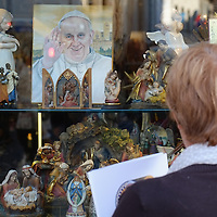 ASSISI, ITALY - OCTOBER 03:  A pilgrim looks at souvenirs and memorabilia in Assisi ahead of the visit of Pope Francis on October 3, 2013 in Assisi, Italy. Pope Francis is due to venerate the tomb of San Francesco of Assisi tomorrow during his one-day visit to the city.  (Photo by Marco Secchi/Getty Images)