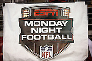 The ESPN Monday Night Football logo is imprinted on a sideline banner during the Arizona Cardinals NFL week 1 regular season football game against the San Diego Chargers on Monday, Sept. 8, 2014 in Glendale, Ariz. The Cardinals won the game 18-17. ©Paul Anthony Spinelli