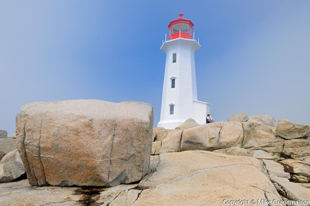 Lighthouse and rocky shoreline <br /> Peggy's Cove<br /> Nova Scotia<br /> Canada