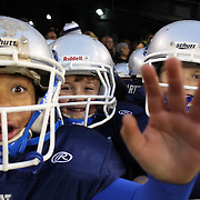 Young American Football players wait in the tunnel to play in front of the crowd at half time during the New York Jets Vs Miami Dolphins  NFL American Football game at MetLife Stadium, East Rutherford, NJ, USA. 1st December 2013. Photo Tim Clayton