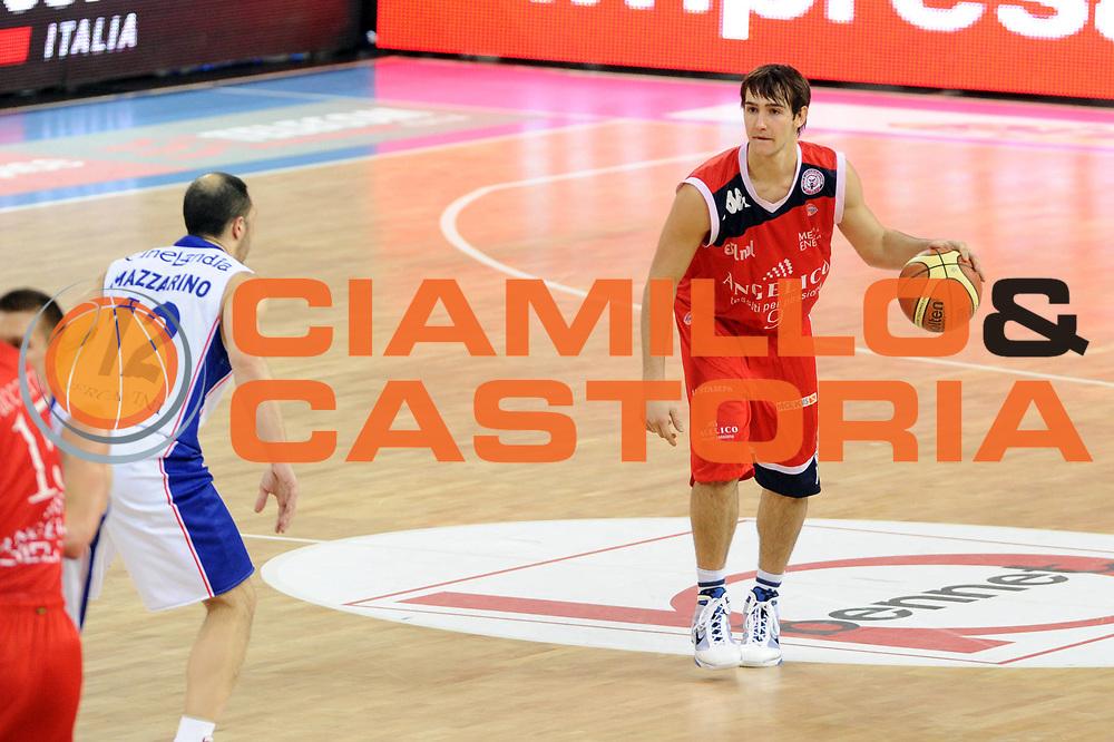 DESCRIZIONE : Torino Coppa Italia Final Eight 2011 Quarti di Finale Bennet Cantu Angelico Biella<br /> GIOCATORE : Riccardo Moraschini<br /> SQUADRA : Angelico Biella<br /> EVENTO : Agos Ducato Basket Coppa Italia Final Eight 2011<br /> GARA : Bennet Cantu Angelico Biella<br /> DATA : 11/02/2011<br /> CATEGORIA : palleggio<br /> SPORT : Pallacanestro<br /> AUTORE : Agenzia Ciamillo-Castoria/GiulioCiamillo<br /> Galleria : Final Eight Coppa Italia 2011<br /> Fotonotizia : Torino Coppa Italia Final Eight 2011 Quarti di Finale Bennet Cantu Angelico Biella<br /> Predefinita :
