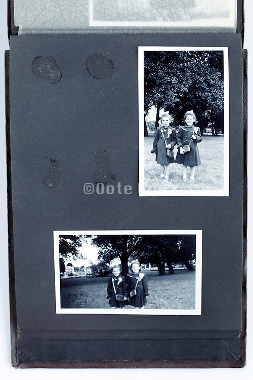 photo album with missing image and twin sisters 1950s