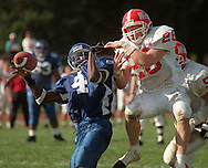 Cheyney University's Jason Andrews (4) has a pass knocked down by East Stroudsburg University's Jason Matters (28) in the second half, on Saturday, Oct. 17th, 1998, in Cheyney, PA. Cheyney lost to East Stroudburg 36-26 for their 51st game without a win, and their 38th consecutive loss. On Saturday, Oct. 10th, 1998 Cheyney set a new Division II record with their 50th game without a win. (AP Photo/William Thomas Cain)