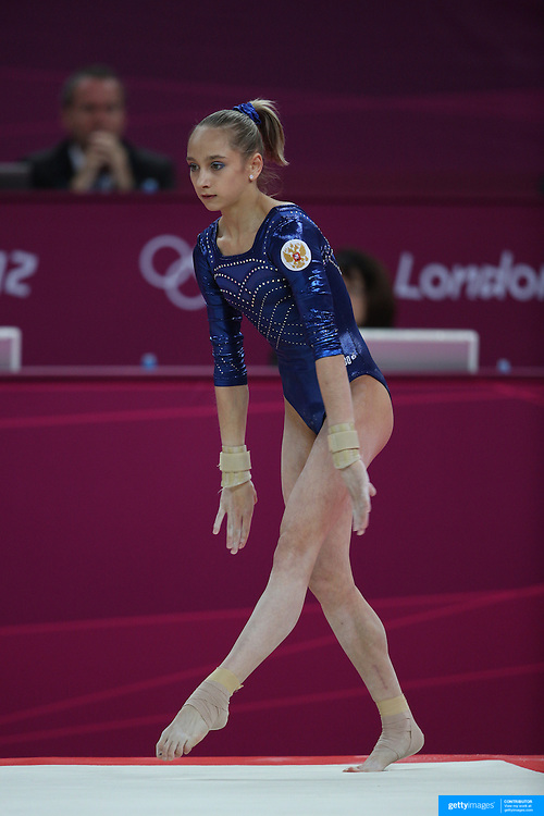 Victoria Komova, Russia, in action on the Floor Routine during the Women's Individual All-Around competition in which she won the Silver Medal at North Greenwich Arena, during the London 2012 Olympic games. London, UK. 2nd August 2012. Photo Tim Clayton
