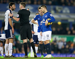 LIVERPOOL, ENGLAND - Monday, January 19, 2015: Everton's Kevin Mirallas takes the ball and refuses to let regular penalty taker Leighton Baines take the penalty kick against West Bromwich Albion during the Premier League match at Goodison Park. (Pic by David Rawcliffe/Propaganda)
