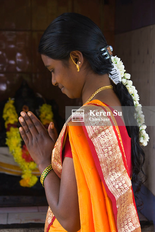 Girl in traditional costume during Onam Festival, Kerala State, India