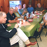(Floyd Ingram / Buy at photos.chickasawjournal.com)<br /> U.S. Representative Trent Kelly (R-Miss), on left, makes a point to those at Moore's Restaurant during a visit to Houston, Tuesday, Aug. 16, 2016. Kelly also visited with the coffee crowd at Hardees earlier in the morning.