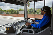 A smiley bus driver in a Nottingham Community Transport hat in Nottingham, Nottinghamshire, United Kingdom. Nottingham uses electric buses as part of the council's plan to clear the city air and become more eco-friendly.  (photo by Andrew Aitchison / In pictures via Getty Images)