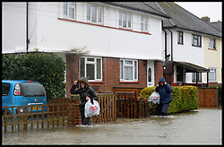 Residents in Egham struggle through the floods as it  hits the town, United Kingdom, Wednesday, 12th February 2014. Picture by Andrew Parsons / i-Images