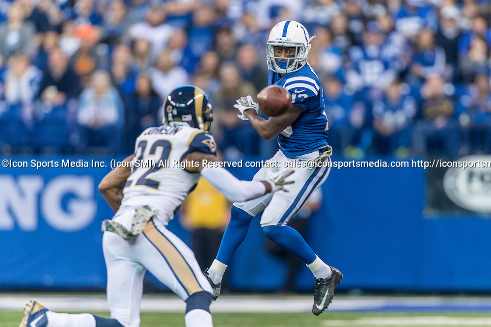 November 10, 2013:   Indianapolis Colts wide receiver T.Y. Hilton (13) battles with St. Louis Rams cornerback Trumaine Johnson (22) for a loose air ball in action during a football game between the Indianapolis Colts and the St. Louis Rams at Lucas Oil Stadium in Indianapolis, IN.