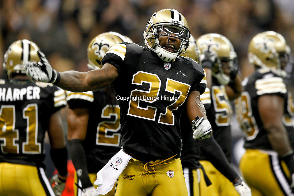September 25, 2011; New Orleans, LA, USA; New Orleans Saints safety Malcolm Jenkins (27) pumps up the crowd during the second quarter against the Houston Texans at the Louisiana Superdome. Mandatory Credit: Derick E. Hingle