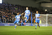 Dale Stephens celebrates after scoring Brighton's opening goal during the Sky Bet Championship match between Brighton and Hove Albion and Derby County at the American Express Community Stadium, Brighton and Hove, England on 3 March 2015. Photo by Geoff Penn.