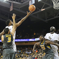 ORLANDO, FL - NOVEMBER 30: Ceasar DeJesus #4 of the UCF Knights drives to the net in front of Kassius Robertson #3 and Jeremiah Tilmon #23 of the Missouri Tigers during a NCAA basketball game at the CFE Arena on November 30, 2017 in Orlando, Florida. (Photo by Alex Menendez/Getty Images) *** Local Caption *** Ceasar DeJesus; Kassius Robertson; Jeremiah Tilmon
