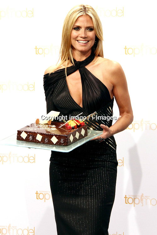 59714202  German model Heidi Klum  poses with a birthday cake prior to Klum's June 1 birthday at a photo call for the reality television show and modelling competition 'Germany's Next Topmodel' at Waldorf Astoria on May 27, 2013 in Berlin, Germany..UK ONLY