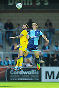 Callum Kennedy (23) of AFC Wimbledon and Dayle Southwell (15) of Wycombe Wanderers jump to head the ball during the Pre-Season Friendly match between Wycombe Wanderers and AFC Wimbledon at Adams Park, High Wycombe, England on 25 July 2017. Photo by Graham Hunt.