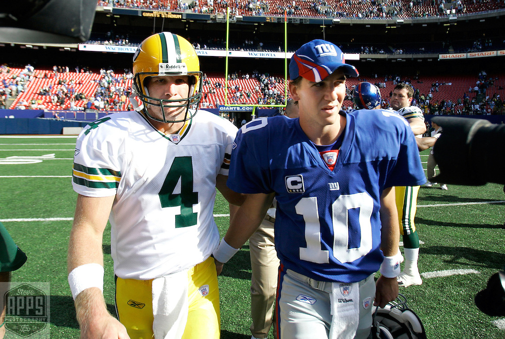 .Green Bay Packers' Brett Favre and New York Giants' Eli Manning walk off the field after the Packers beat the Giants 35-13..The Green Bay Packers traveled to Giants Stadium in East Rutherford, NJ to play the NY Giants Sunday September 16, 2007. Steve Apps-State Journal.