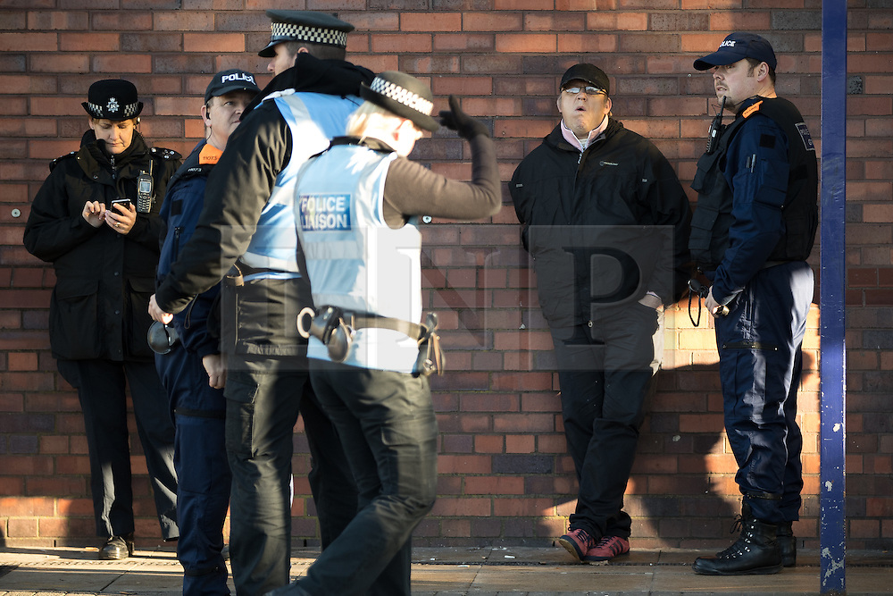 "© Licensed to London News Pictures . 26/11/2016 . Bolton , UK . Police detain a man outside Bolton Station . Approximately 100 people attend a demonstration against the construction of mosques in Bolton , under the banner "" No More Mosques "" , organised by a coalition of far-right organisations and approximately 150 anti fascists opposing the demonstration , in Victoria Square in Bolton Town Centre . Photo credit : Joel Goodman/LNP"