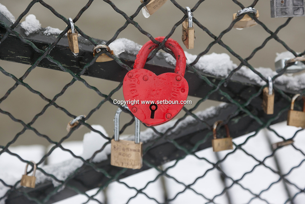 France. Paris.  love locks on the pont des Arts on the Seine river / Paris, Pont des arts. cadenas d amour sur   la passerelle des arts sur la Seine
