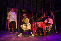 "Sam Wheat (Nick Moulton) speaks to Psychic Oda Mae Brown (Tiffany Renee Thompson) in the mortal world while she's in a reading for Mrs. Santiago (Liz Neitge) with Louise (Cameron Silliman) and Clara (Hannah Fields) during dress rehearsal for ""Ghost"" at the Winnipesaukee Playhouse.  (Karen Bobotas/for the Laconia Daily Sun)"