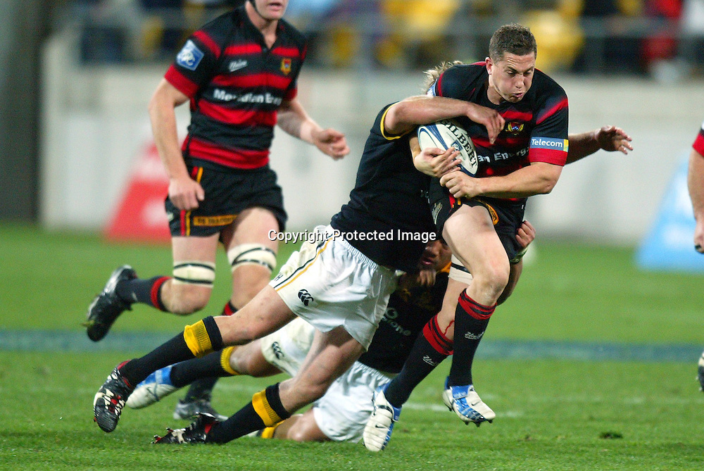 13 August 2004, Westpac Stadium, Wellington, <br /> New Zealand, Rugby Union, NPC Div 1<br /> Wellington Lions vs Canterbury<br /> Canterbury's Cameron McIntyre gets tackled by Lion's Ma'a Nonu and Ben Herring during Wellington's 34-22 win over Canterbury on Friday night.<br /> Please Credit: Marty Melville/Photosport