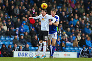 Crewe Alexandra forward Callum Saunders and Chesterfield FC defender Tom Anderson challenge for the ball during the Sky Bet League 1 match between Chesterfield and Crewe Alexandra at the Proact stadium, Chesterfield, England on 20 February 2016. Photo by Aaron Lupton.