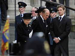 © Licensed to London News Pictures. 17 April 2013. St Paul's Cathedral London. The Queen talks to the Thatcher family after the service. Funeral of Baroness Thatcher, former Conservative Prime Minister. Photo credit : MarkHemsworth/LNP