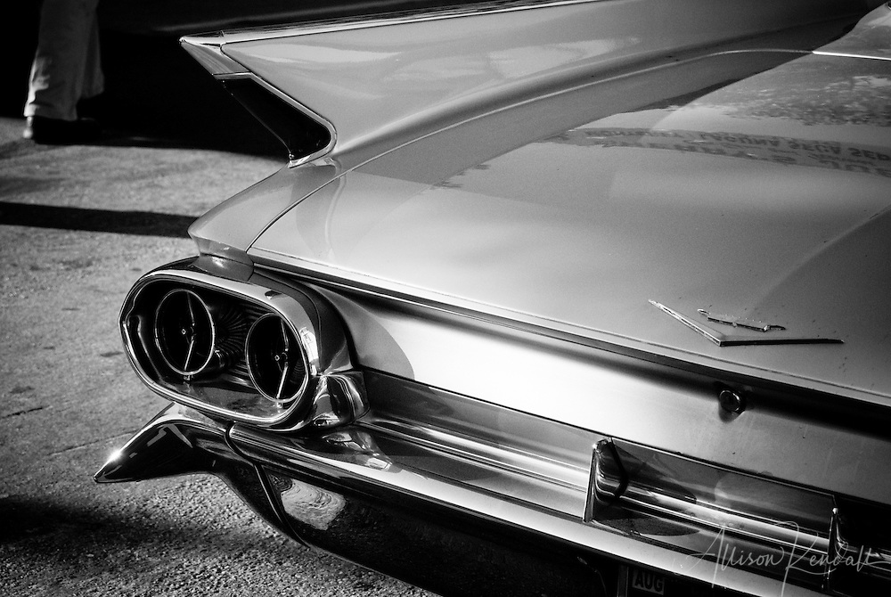 Vintage form of classic automobile fins and shining chrome trim reflect the long light and shadow of an indian summer afternoon.