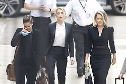 © Licensed to London News Pictures. 24/07/2020. London, UK. American actor AMBER HEARD arrives at the High Court in London where Johnny Depp is in a legal dispute with UK tabloid newspaper The Sun over allegations he assaulted his former wife, Amber Heard. Photo credit: Peter Macdiarmid/LNP