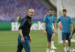 May 25, 2018 - Kiev, Ukraine - Real Madrid's head coach Zinedine Zidane (L) attends a training session at the Olimpiyskiy Stadium in Kiev, Ukraine, 25 May 2018.The 2018 UEFA Champions League Cup final football match between Real Madrid and Liverpool FC will held on May 26 at the Olimpiyskiy Stadium. (Credit Image: © Str/NurPhoto via ZUMA Press)