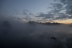 © Licensed to London News Pictures. 26/09/2015. City, UK. Sunrise on a misty cold Autumn Morning in Richmond Park, London. Photo credit : Ian Schofield/LNP