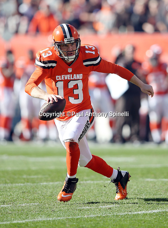 Cleveland Browns quarterback Josh McCown (13) scrambles as he looks to pass in the second quarter during the 2015 week 8 regular season NFL football game against the Arizona Cardinals on Sunday, Nov. 1, 2015 in Cleveland. The Cardinals won the game 34-20. (©Paul Anthony Spinelli)