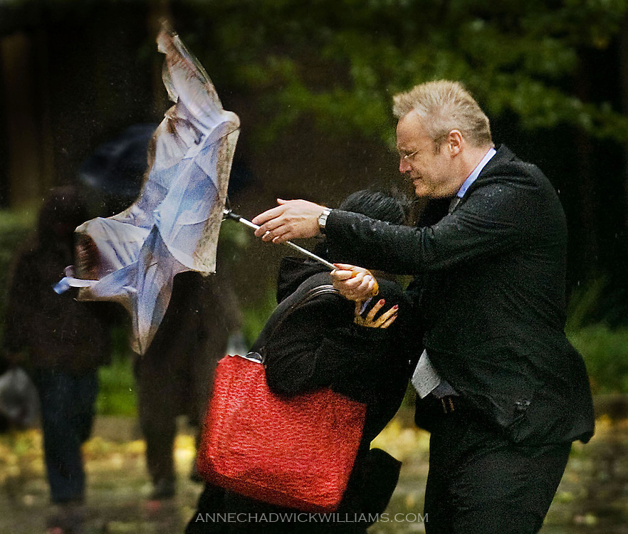 During a nasty storm in Sacramento, California, Gordan Vidovic struggles with his umbrella, which was also covering friend Shannon Eng on  Oct.,13, 2009. The graduates from St. Mary's College of California in Moraga were in town for a reception with the Gov. Arnold Schwarzenegger.