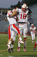 Cedar Falls' Jake Buck (6) and Austin Mennen (26) celebrate with Ike Boettger (18) after Boettger's touchdown reception during the game between Cedar Falls and Cedar Rapids Washington at Kingston Stadium in Cedar Rapids on Friday, September 7, 2012.