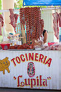 Pork sausages and pork cuts at the Sunday market in Tlacolula de Matamoros, Mexico. The regional street market draws thousands of sellers and shoppers from throughout the Valles Centrales de Oaxaca.