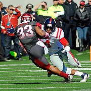 Arkansas running back Dennis Johnson (33) runs the ball as Mississippi linebacker Denzel Nkemdiche (4) covers during an NCAA college football game in Little Rock, Ark., Saturday, Oct. 27, 2012. (Photo/Thomas Graning)