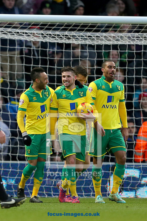 Gary Hooper of Norwich City (centre) is congratulated by team mate, Nathan Redmond (left) after scoring the third goal and completing his hat-trick during the Sky Bet Championship match against Blackpool at Carrow Road, Norwich<br /> Picture by Richard Calver/Focus Images Ltd +447792 981244<br /> 07/02/2015