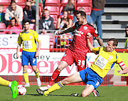 Crawley Town striker Rhys Murphy, on loan from Oldam Athletic,  is tackled by Accrington Stanley defender Dean Winnard during the Sky Bet League 2 match between Crawley Town and Accrington Stanley at the Checkatrade.com Stadium, Crawley, England on 26 September 2015. Photo by Bennett Dean.
